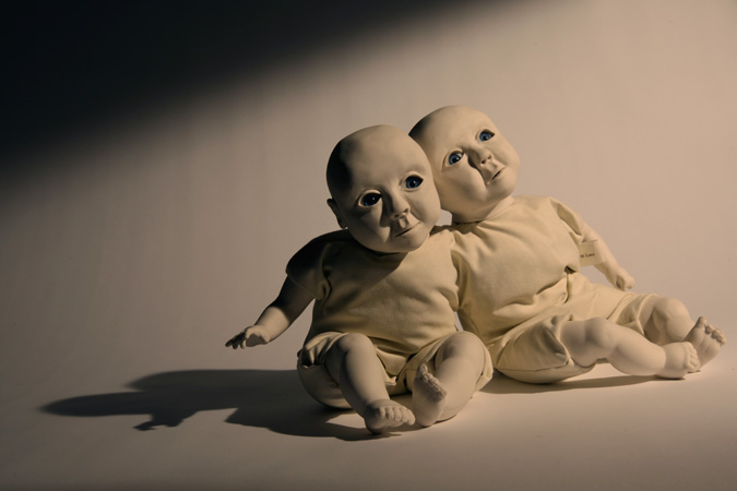 'Babies to love' Slip-cast porcelain from hand modelled wax and doll parts, glass eyes and textiles. Photography by Jonny Briggs.