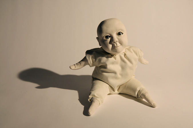 'Babies to love' Slip-cast porcelain from hand modelled wax and cast of my fingers, with glass eyes and textiles. Photography by Jonny Briggs.